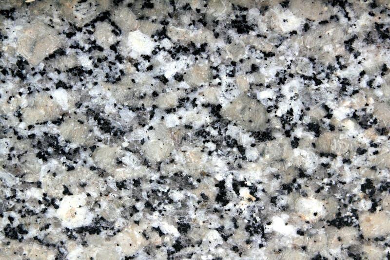 Primo piano di struttura della pietra del nero di bianco grigio del granito immagine stock libera da diritti