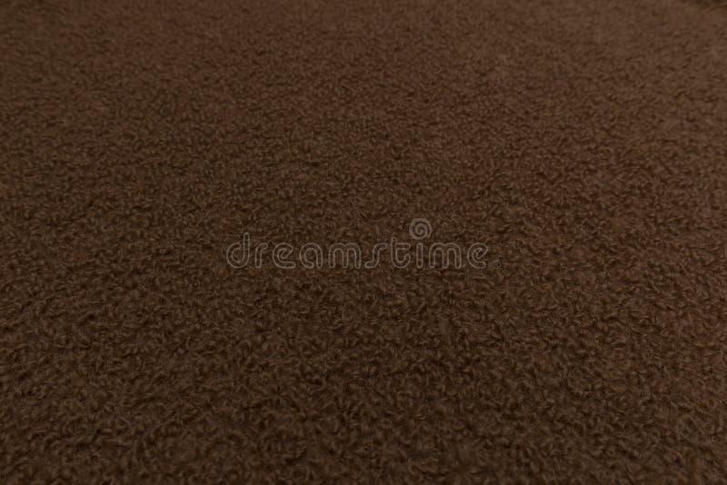Primo piano di tessuto marrone con il fondo di struttura del tessuto royalty illustrazione gratis