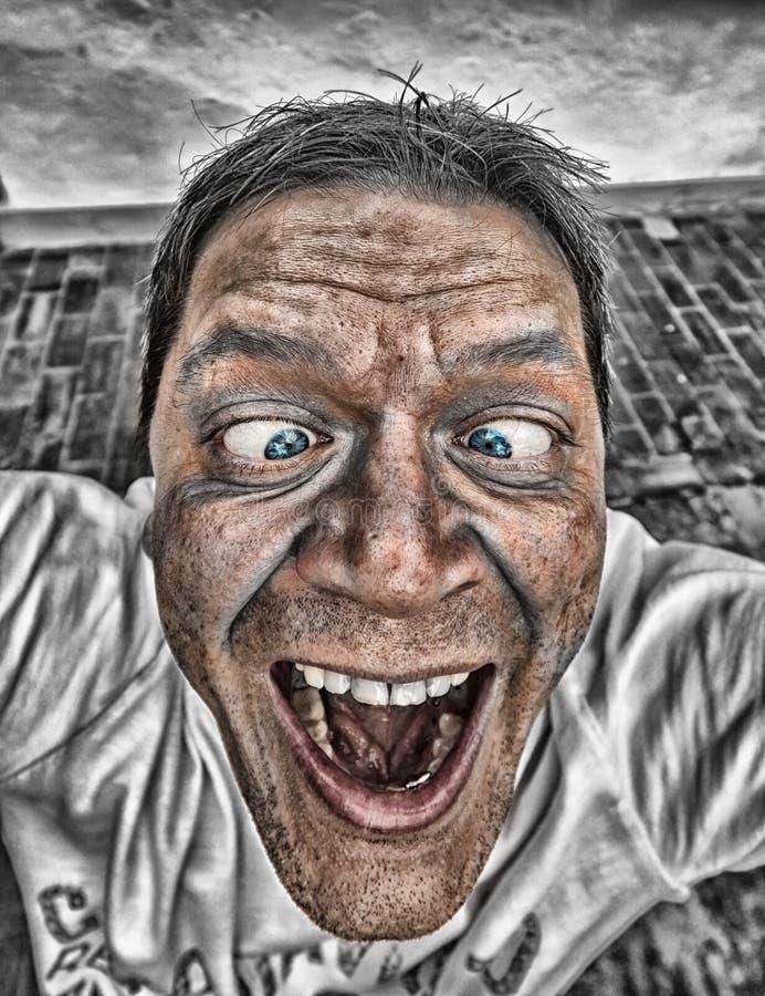 Primo piano di un uomo con il fronte comico fotografie stock libere da diritti
