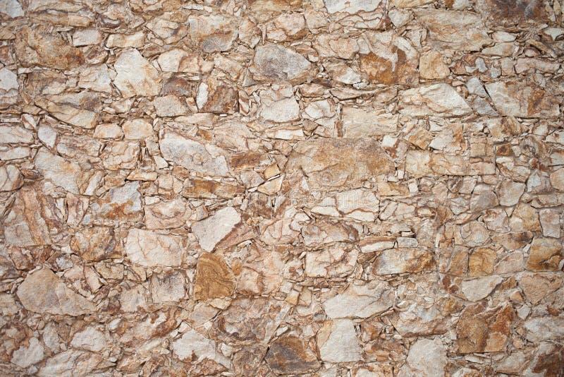 Primo piano di vecchia struttura variopinta della parete di pietra, fondo Recinti di pietra fotografia stock libera da diritti