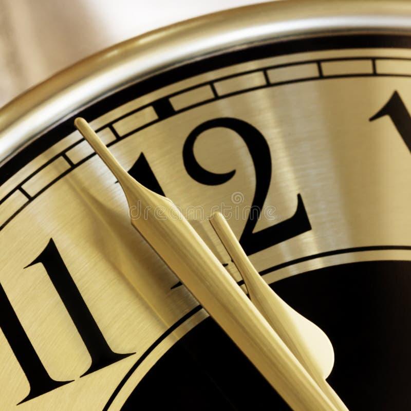Primo piano dorato del fronte di orologio immagini stock libere da diritti