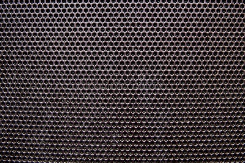 Primo piano nero della griglia dell'altoparlante del fondo fotografia stock