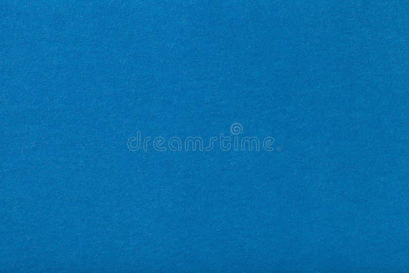 Primo piano opaco blu-chiaro del tessuto della pelle scamosciata Struttura del velluto di feltro immagini stock