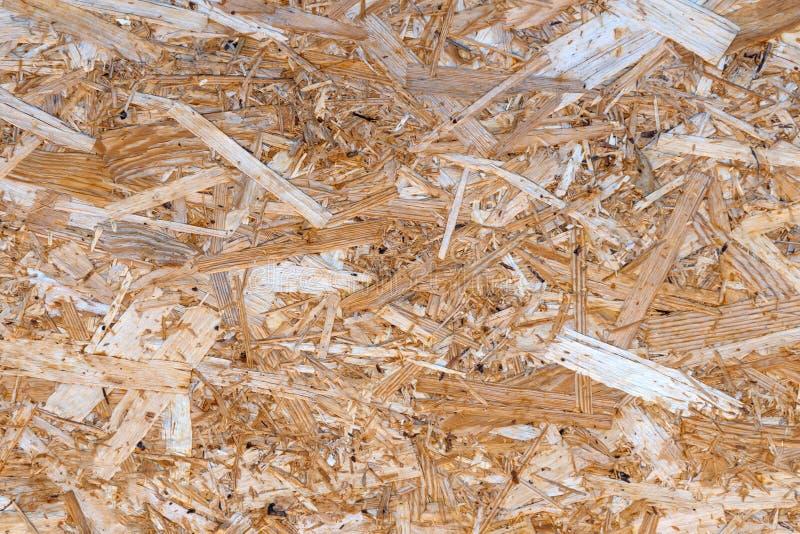 Primo piano orientato di struttura del bordo del filo, fondo di OSB, materiale da costruzione di legno fotografia stock