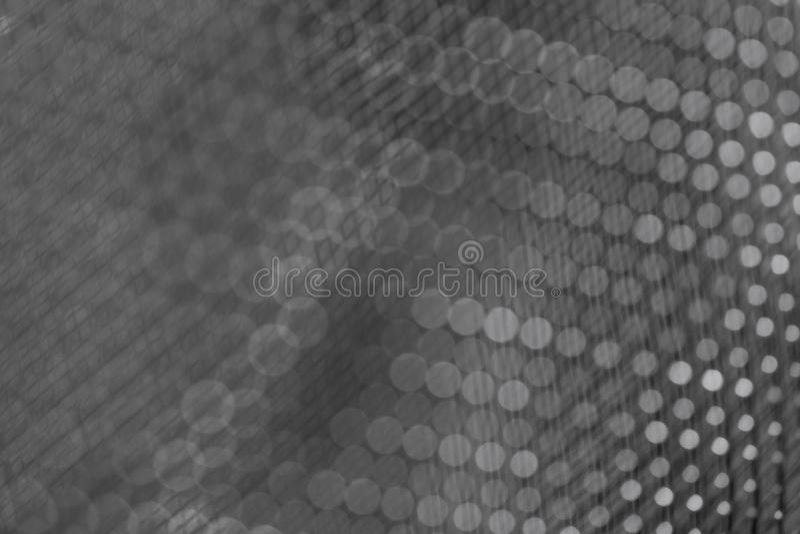 Primo piano scuro del fondo della maglia metallica brillante fotografie stock libere da diritti