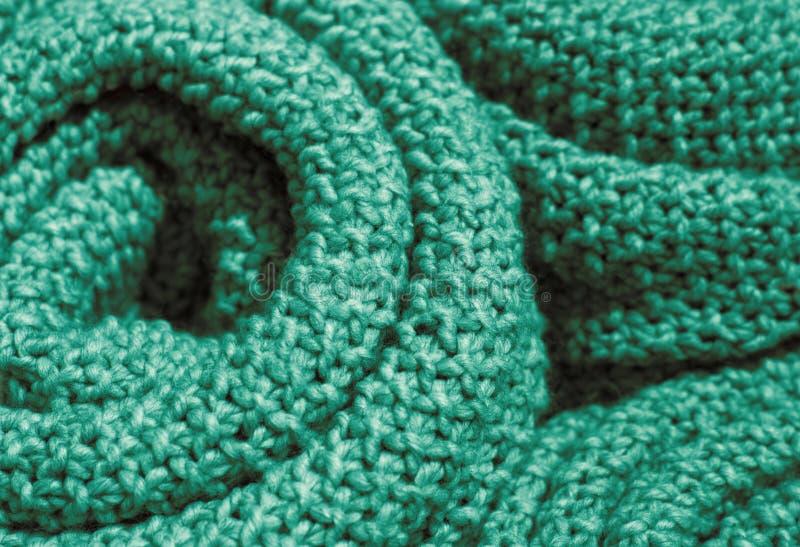 Primo piano tricottato di lana d'avanguardia del tessuto di colore verde del quetzal, struttura, fondo fotografia stock libera da diritti