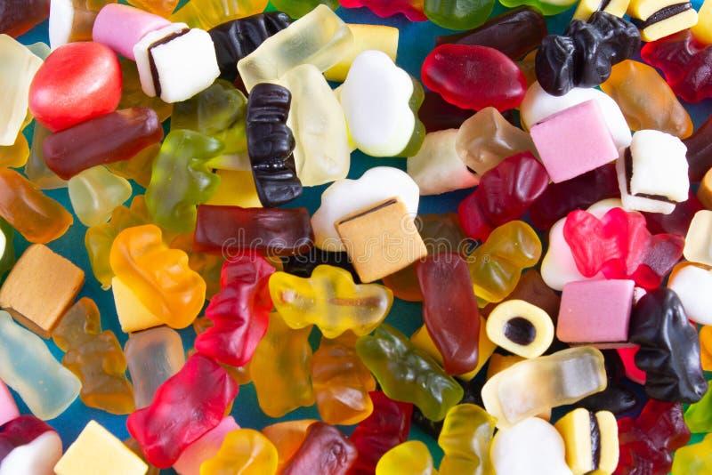 Primo piano variopinto delle caramelle come fondo immagine stock libera da diritti