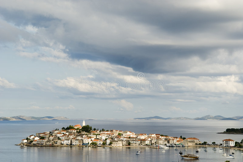 Primosten View. From main street in a cloudy day with lands and islands in the background - Croazia 2007 royalty free stock images