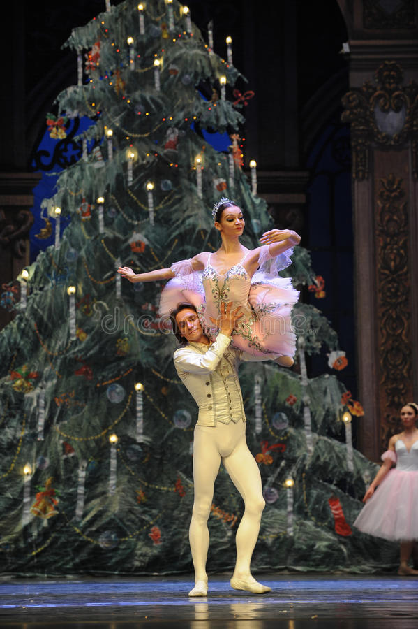 The prince Clara hold up-The Ballet Nutcracker. Ukraine Kiev theatre ballet dancers perform the Nutcracker in Nanchang in December 16, 2014 in Jiangxi province royalty free stock photos