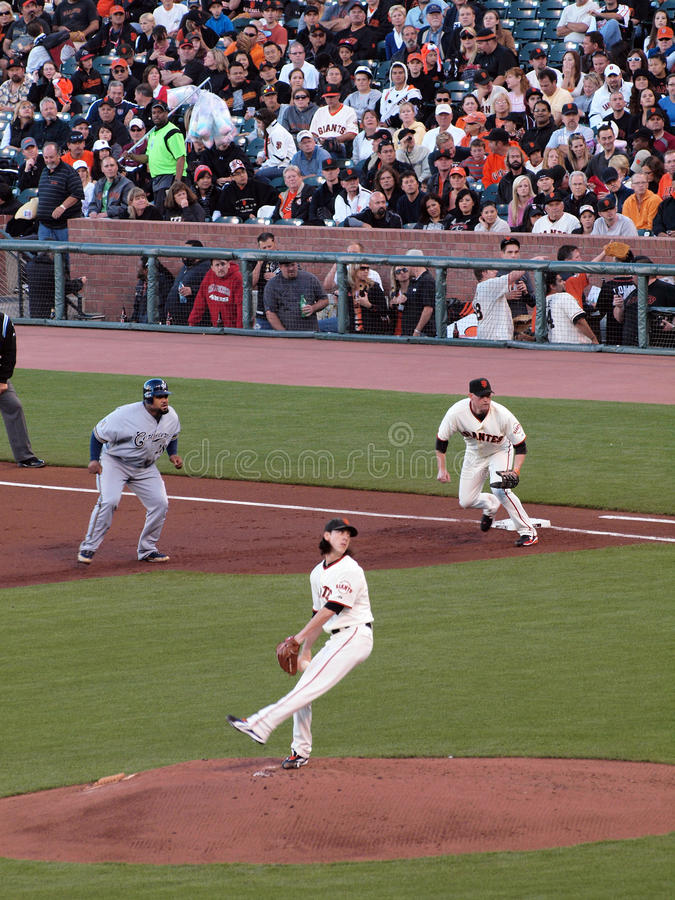 Prince Fielder takes lead at 1st. Brewers vs. Giants: Brewers Prince Fielder takes lead at 1st as Giants Tim Lincecum steps into a throw. September 18 2010 at stock photo