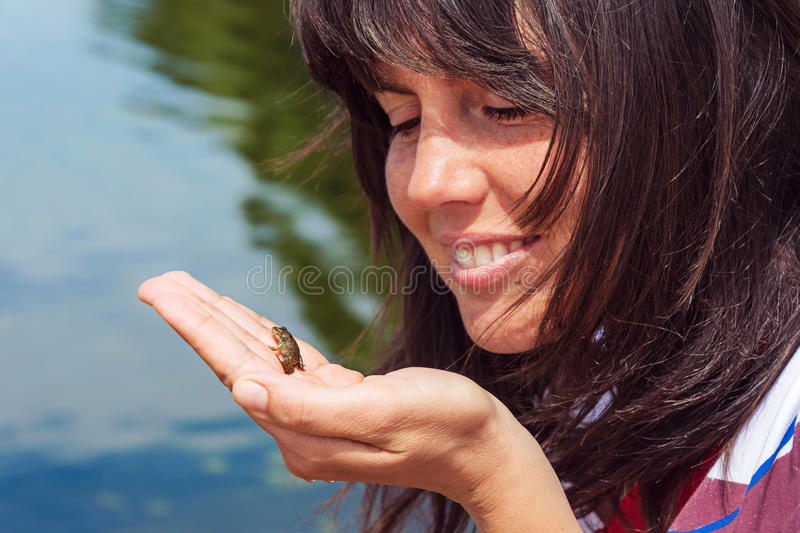 the prince frog and the beautiful woman royalty free stock photography