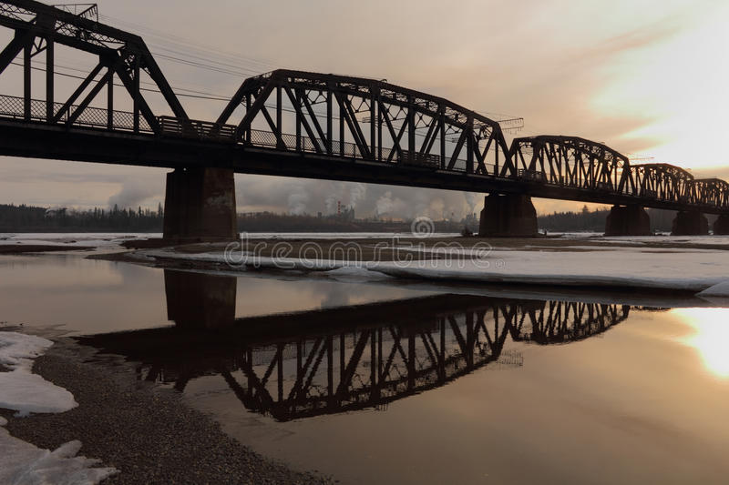 Prince George Rail Bridge, Fraser River. The CN Rail bridge at dawn. Built by the Grand Trunk Pacific Railway in 1914 over the Fraser River in Prince George stock photos