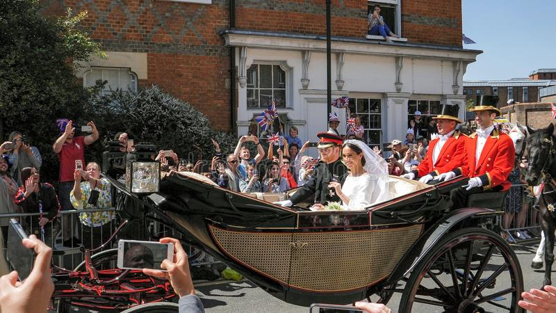 Prince Harry, Duke of Sussex and Meghan, Duchess of Sussex leave. WINDSOR, ENGLAND - MAY 19 2018: Prince Harry, Duke of Sussex and Meghan, Duchess of Sussex royalty free stock photos