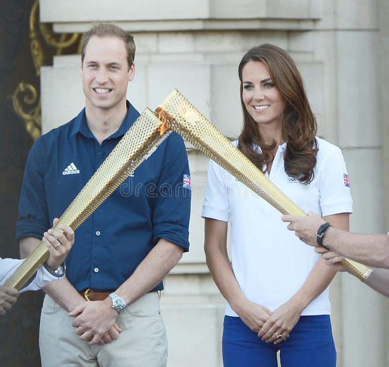 Prince,Prince William. Prince William and Catherine, Duchess of Cambridge welcome the olympic torch to Buckingham Palace, London, UK. July 26, 2012. Picture royalty free stock photography