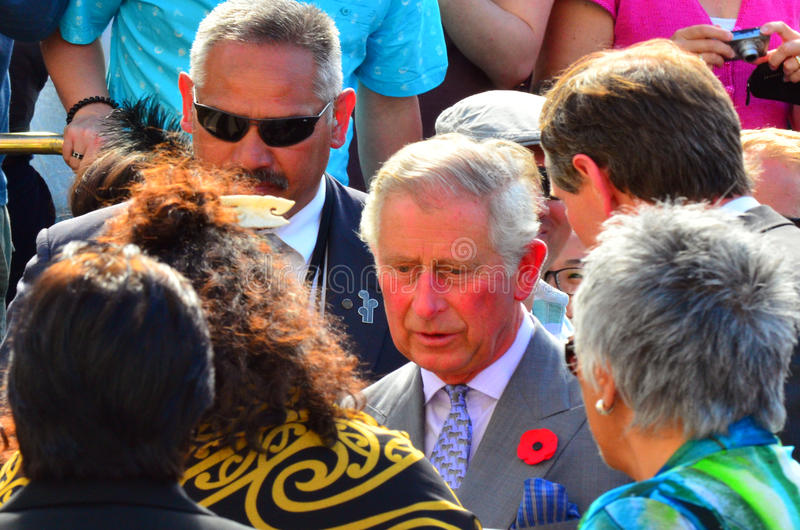 Prince of Wales visit to Auckland New Zealand. AUCKLAND - NOV 08 2015:Prince of Wales (C) arrive at Aotea Square, in Auckland New Zealand for a public walk.He is stock photography