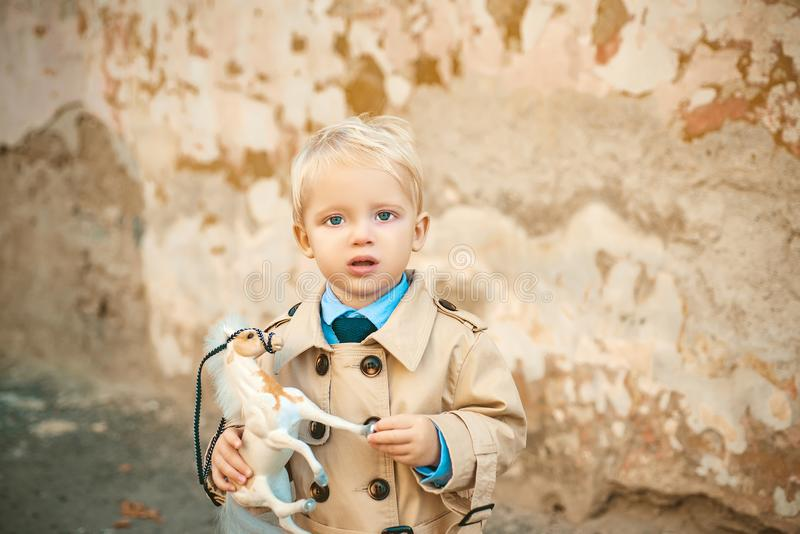 Prince on white horse. small boy prince. small kid with toy horse. happy childhood. childrens day. little boy in vintage royalty free stock photos