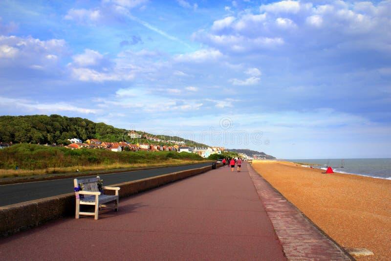 Princes Parade Sandgate Hythe Beach Kent UK. Sandgate Hythe beach promenade and Princes Parade look to the north , Folkestone Kent England UK royalty free stock image