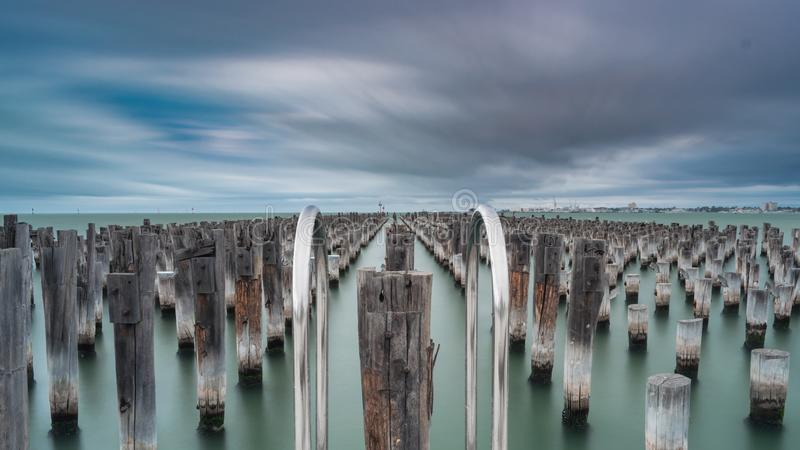 Princes Pier in Port Melbourne, Australia. Stumps in the water at Princes Pier in Port Melbourne, Australia royalty free stock photography