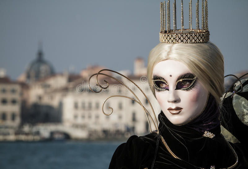 Princess with crown, blondy hair and venetian mask during venice carnival stock image
