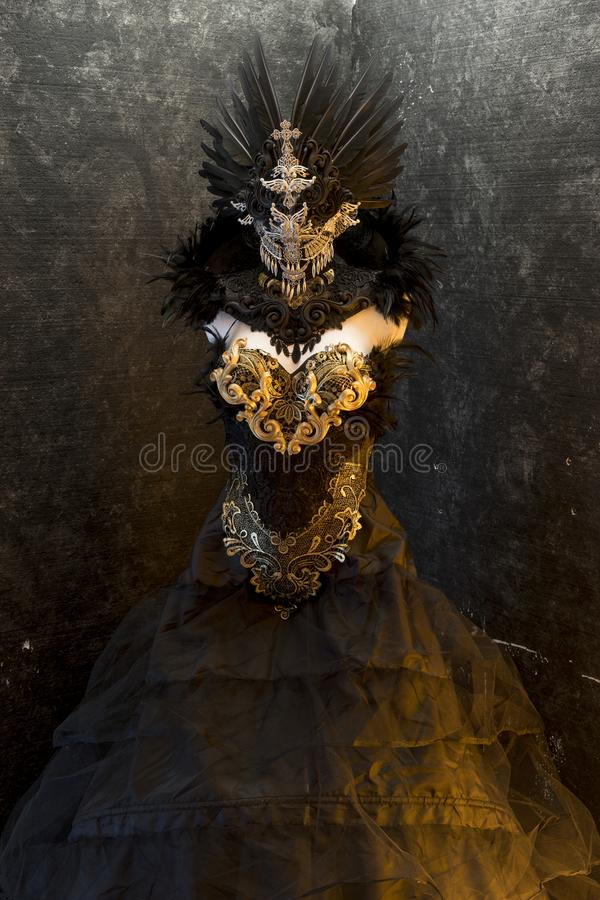 Princess, dark gothic dress formed by a silver metal tiara and a. Golden corset, handmade costume stock images