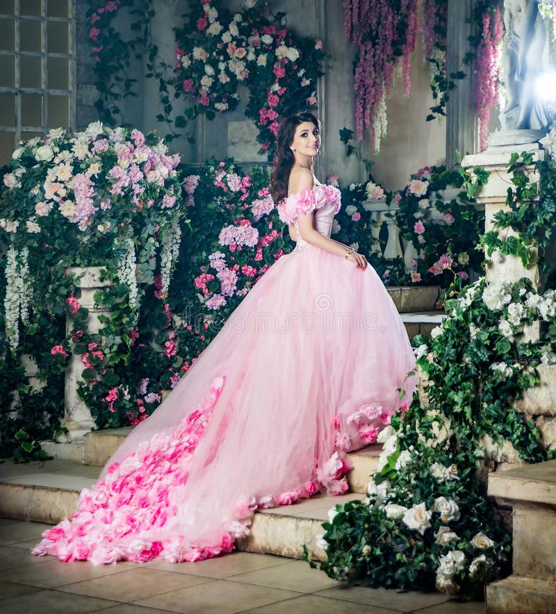 Princess of flowers, mystery fashion model in garden. Spring royalty free stock photos