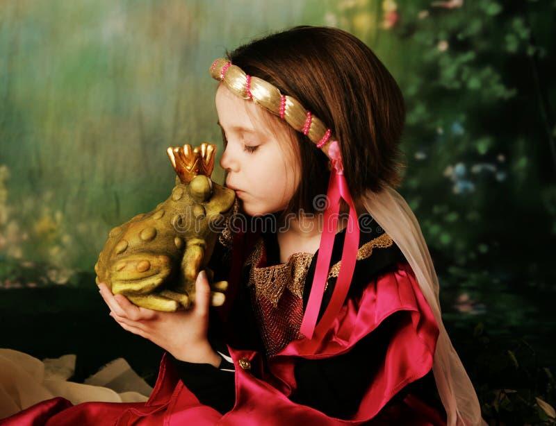 Princess and the frog prince stock photography