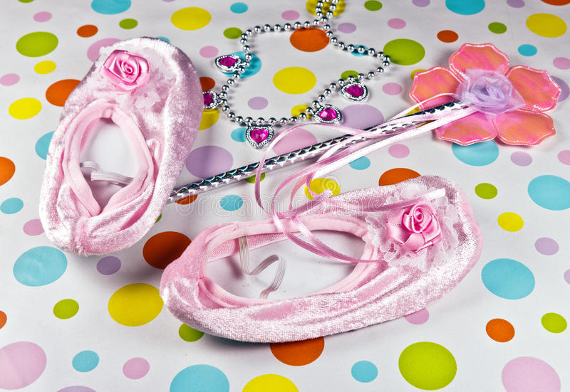 Princess Gear. Including wand, slippers, necklace on a polka dot background stock photography