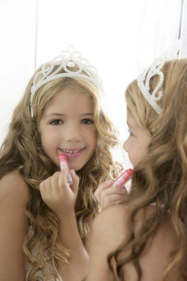 Princess little girl lipstick on mirror stock images
