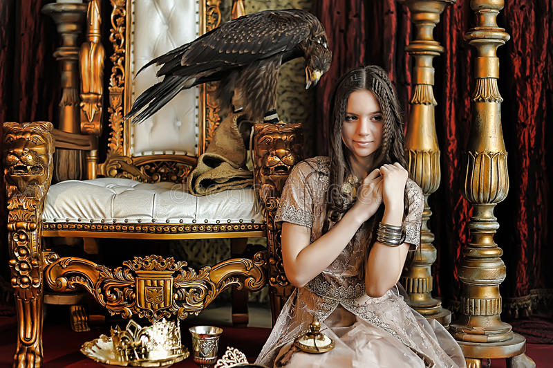 Princess next to the throne. With an eagle sitting stock image