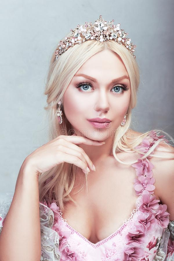 Princess in pink. Beautiful princess in pink gown dress with lace and roses stock photo
