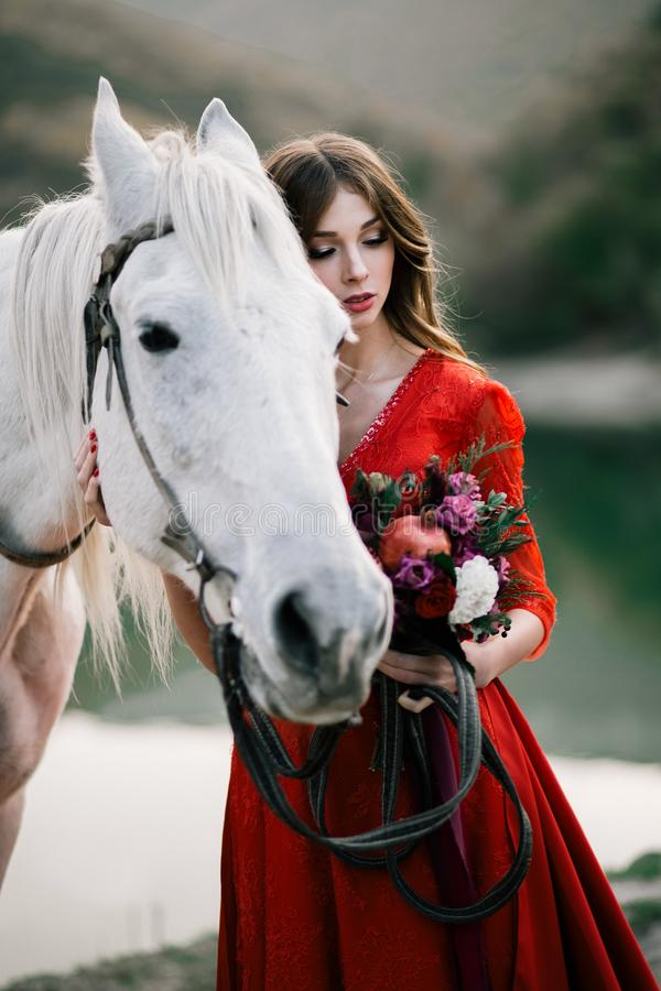 Princess in a red dress from a fairy tale. stock photos