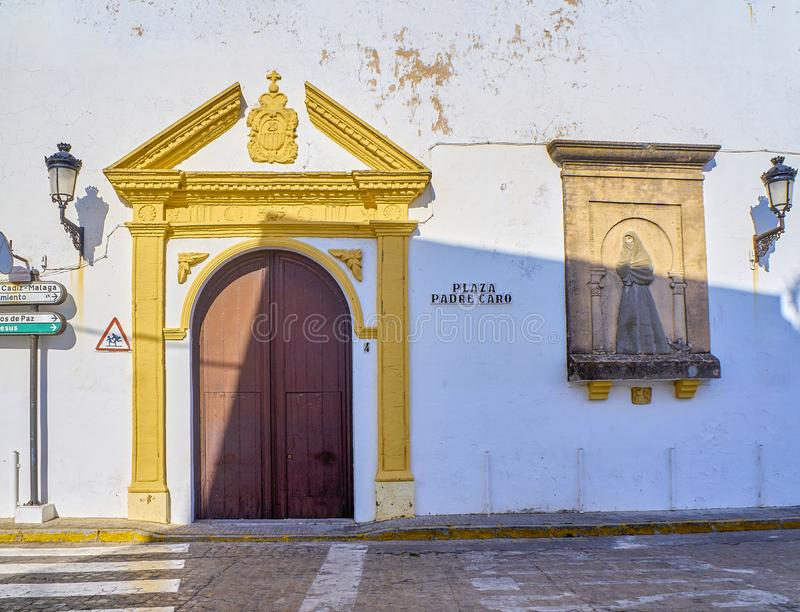 Vejer de la Frontera downtown. Cadiz province, Andalusia, Spain. Principal facade of the Church of Our Lady of Merced de Santa Catalina with the bas-relief of stock photography