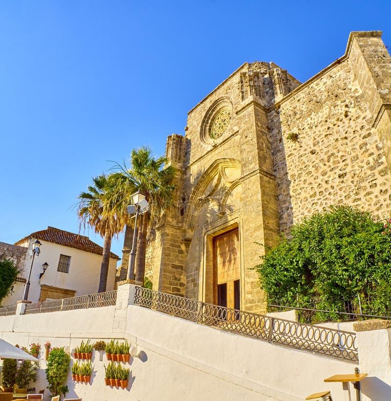 Vejer de la Frontera downtown. Cadiz province, Andalusia, Spain. Principal facade of Divino Salvador church. View from The Nuestra Senora de la Oliva street stock photos