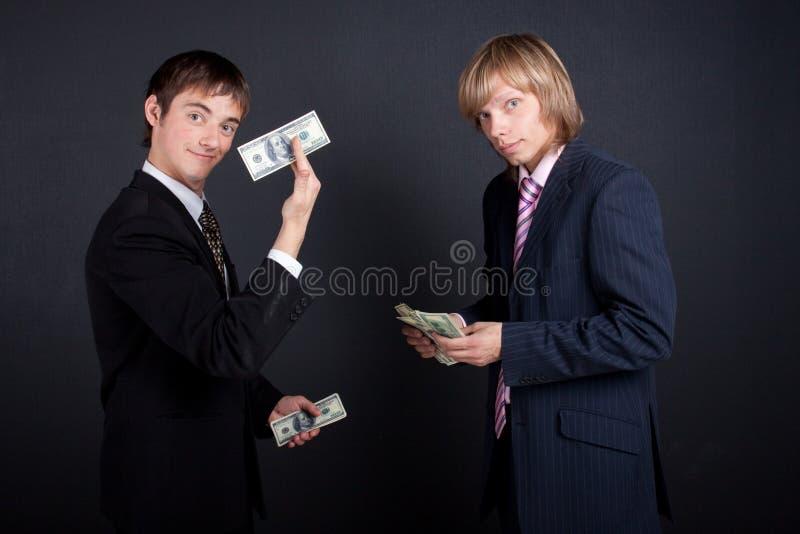 Principal pague un sueldo. imagen de archivo