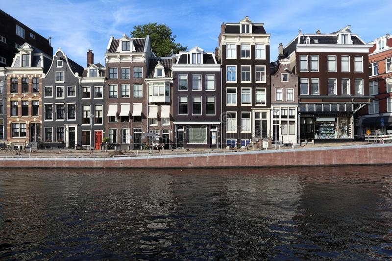 Prinsengracht. Amsterdam canal architecture - Prinsengracht canal rowhouses in De Wallen district royalty free stock image
