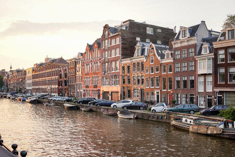 Prinsengracht Amsterdam Canal. Amsterdam - June 12: Prinsengracht canal a beautiful sunset on June 12, 2015 stock image