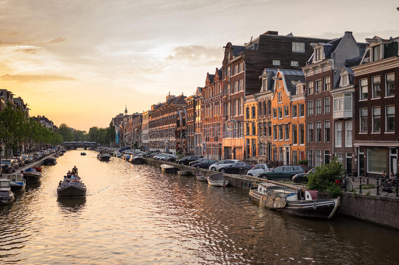 Prinsengracht Amsterdam Canal. Amsterdam - June 12: Prinsengracht canal a beautiful sunset on June 12, 2015 royalty free stock photography
