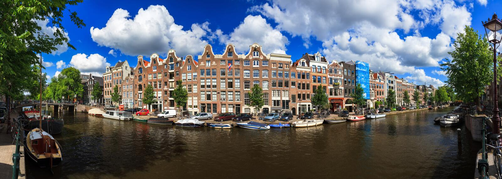 180 Prinsengracht. Beautiful 180 degree panoramic panorama of the UNESCO world heritage Prinsengracht canal in Amsterdam, the Netherlands, on a sunny summer day stock image