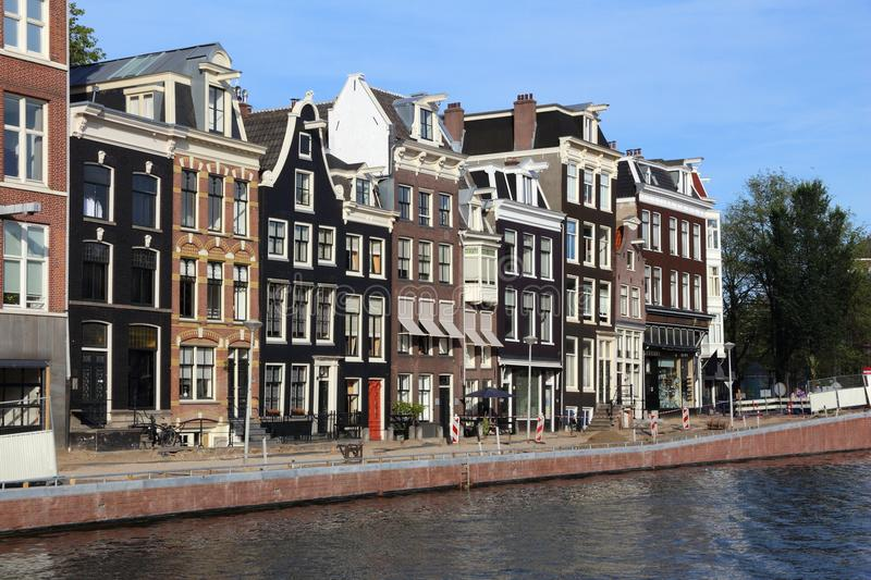 Prinsengracht canal. Amsterdam canal architecture - Prinsengracht canal rowhouses in De Wallen district royalty free stock images