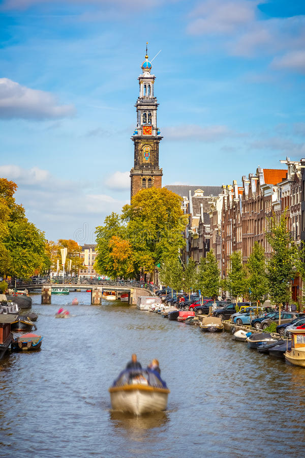 Prinsengracht canal in Amsterdam. Western church and Prinsengracht canal in Amsterdam royalty free stock image