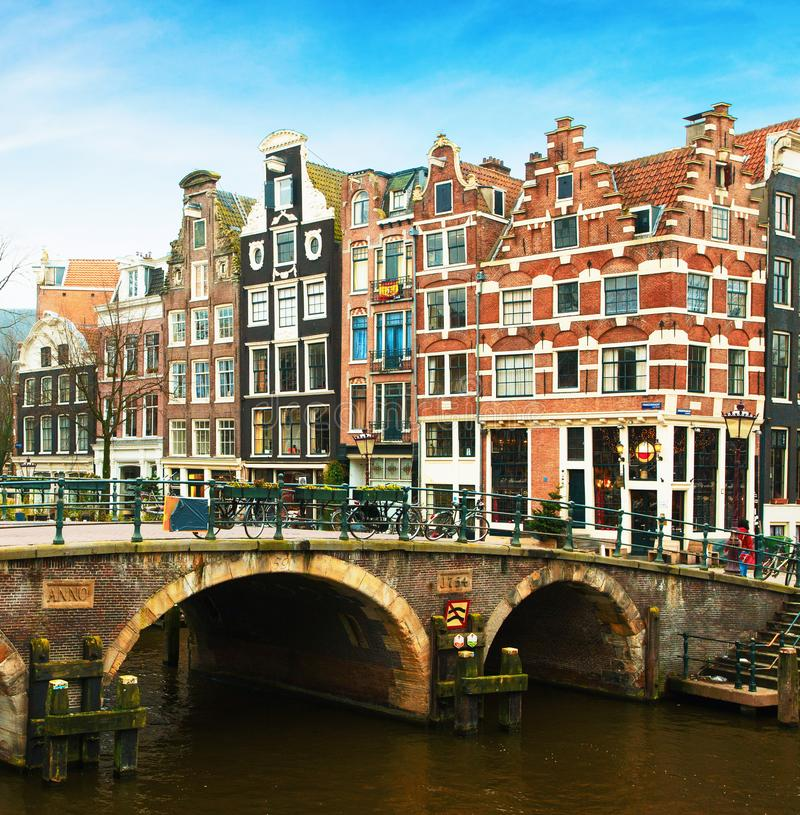Prinsengracht Canal and typical Dutch houses behind the bridge in winter, Amsterdam, The Netherlands.  stock photo