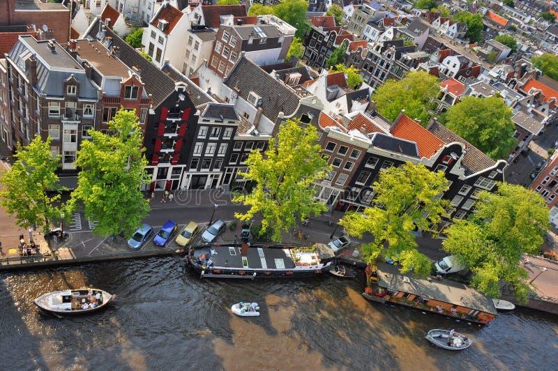 Prinsengracht canal from Westerkerk. Westerkerk, Amsterdam - July 25, 2012: Panorama view from Westerkerk to the south of Amsterdam with the canal Prinsengracht royalty free stock image