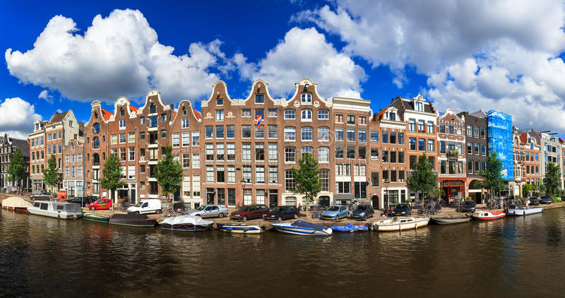 Prinsengracht panorama. Beautiful panoramic linear panorama of the UNESCO world heritage Prinsengracht canal in Amsterdam, the Netherlands, on a sunny summer day royalty free stock photo