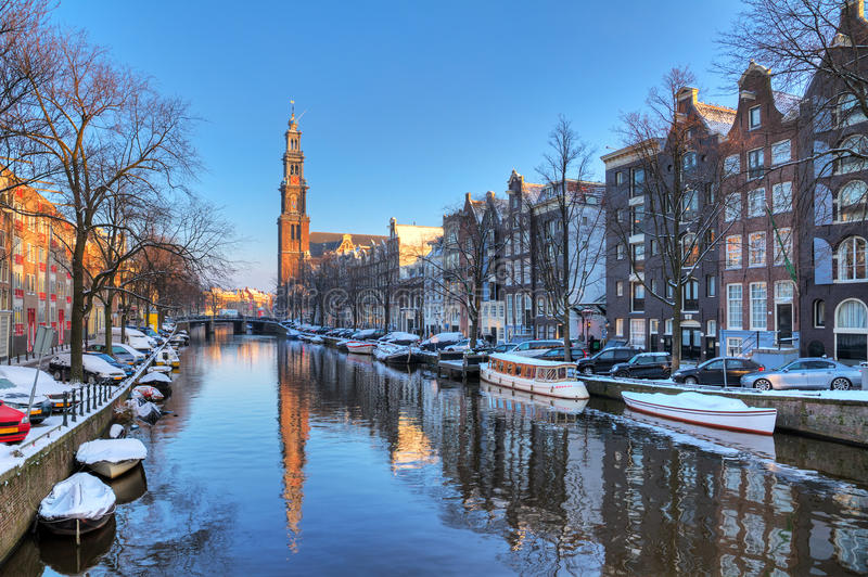 Prinsengracht winter. Beautiful early morning winter view on the Westerkerk and the Prinsengracht, one of the Unesco world heritage city canals of Amsterdam, The stock image
