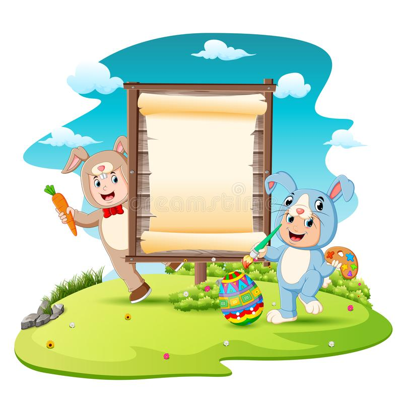 Happy kids wearing bunny costume and painting egg with blank sign background stock illustration