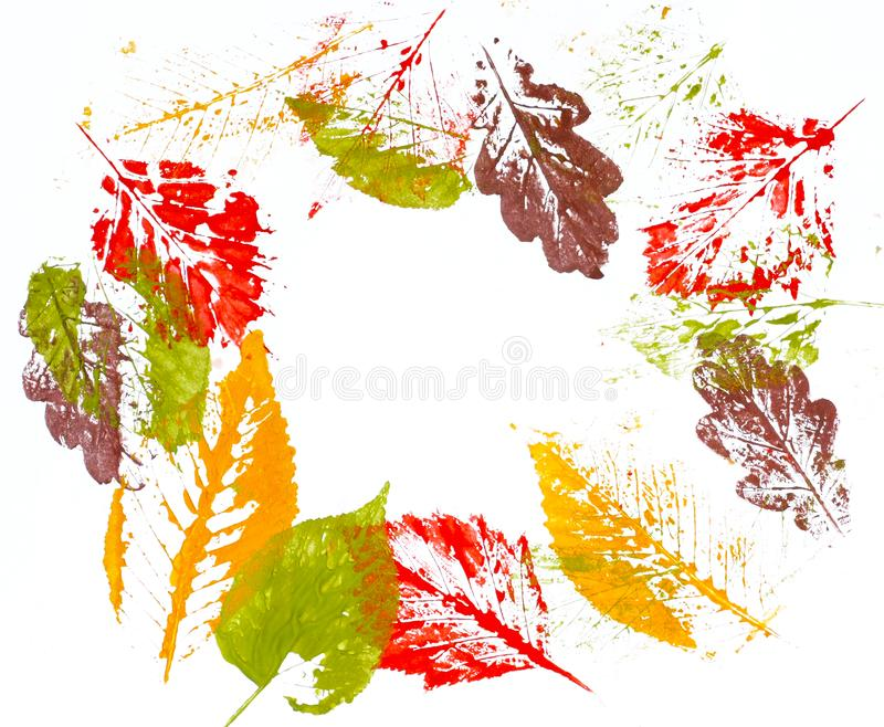 Print colorful autumn leaves on white paper royalty free stock images