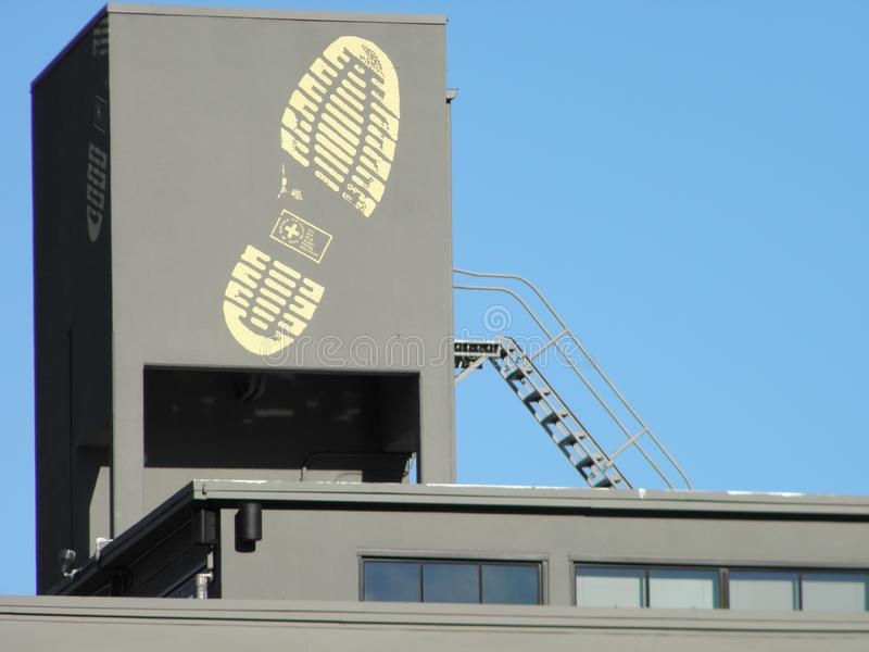Shoe Print on building in downtown Portland, Oregon. This is the print of a Doc Marten book painted on a store building in downtown Portland, Oregon royalty free stock photo