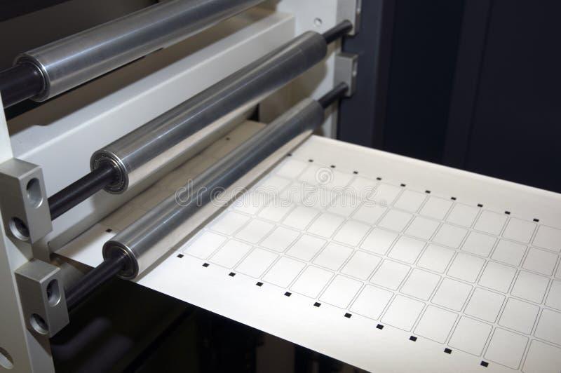 Print finishing equipment for labels