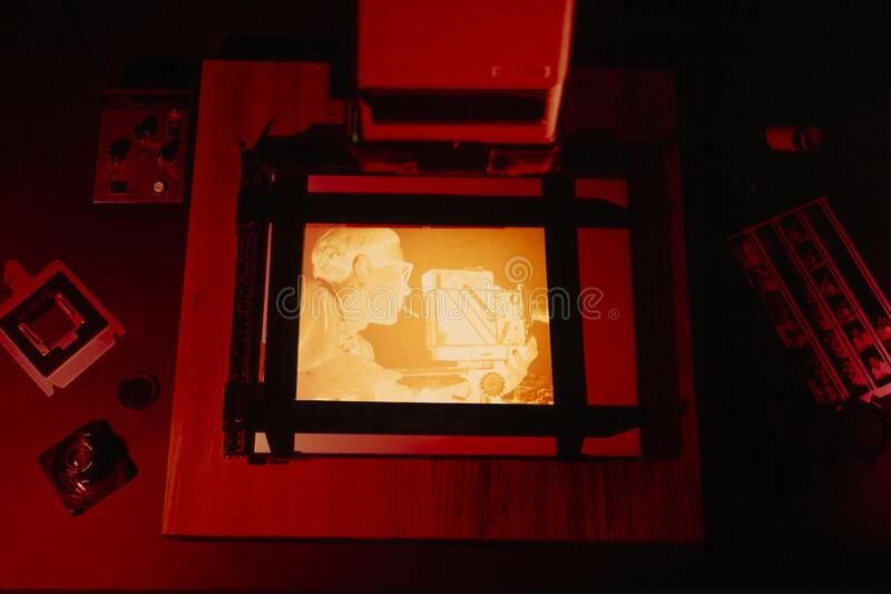 Print a negative film in the photographic darkroom stock image