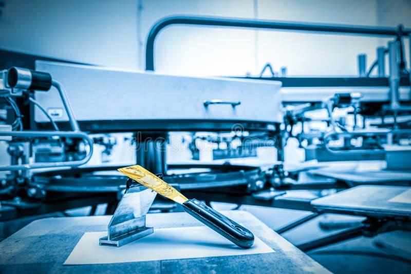 Print screening metal machine. Industrial printer. Print manufacture stock photography